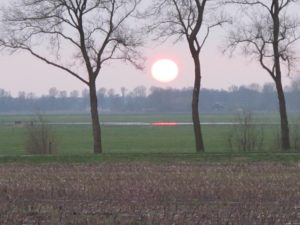 Zonsondergang bij Basse
